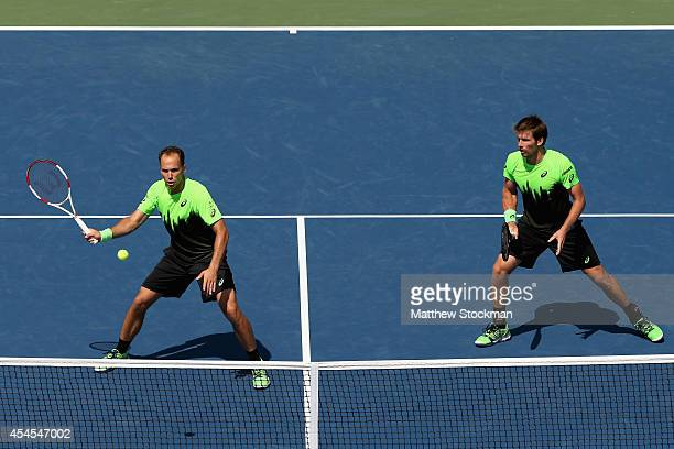 Alexander Peya of Austria and Bruno Soares of Brazil return a shot against Marcel Granollers and Marc Lopez of Spain during their men's doubles...