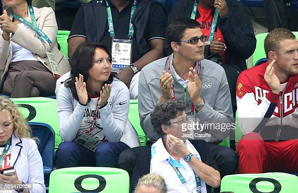 Alexander Popov and his wife Darya Popova attend the swimming finals on day 8 of the Rio 2016 Olympic Games at Olympic Aquatics Stadium on August 13...