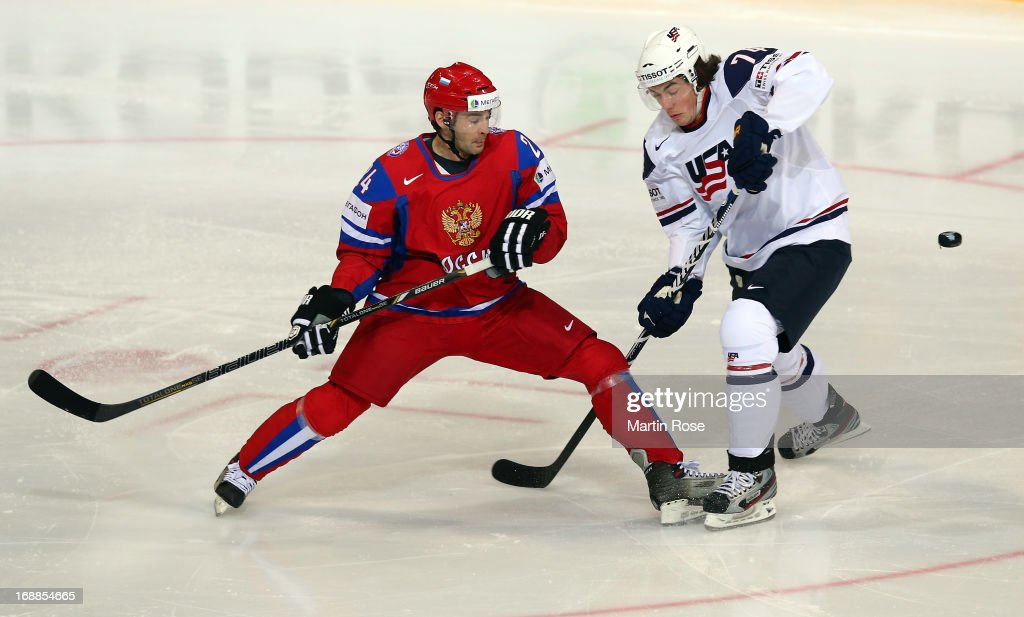 Alexander Popov (L) of Russia and TJ Oshie (R) of USA battle for the puck during the IIHF World Championship quarterfinal match between Russia and USA at Hartwall Areena on May 16, 2013 in Helsinki, Finland.