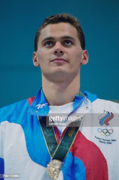 Alexander Popov of Russia celebrates with his gold medal after winning the Men's 100 metres Freestyle event at the XXVI Summer Olympic Games on 22...