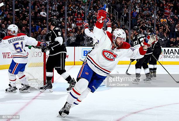 Alexander Radulov and David Desharnais of the Montreal Canadiens celebrate a goal in the second period against Drew Doughty of the Los Angeles Kings...