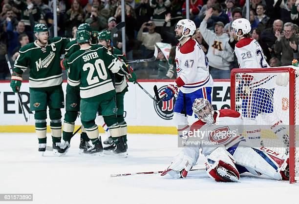 Alexander Radulov Carey Price and Jeff Petry of the Montreal Canadiens react as Minnesota Wild celebrates a goal by Nino Niederreiter during the...