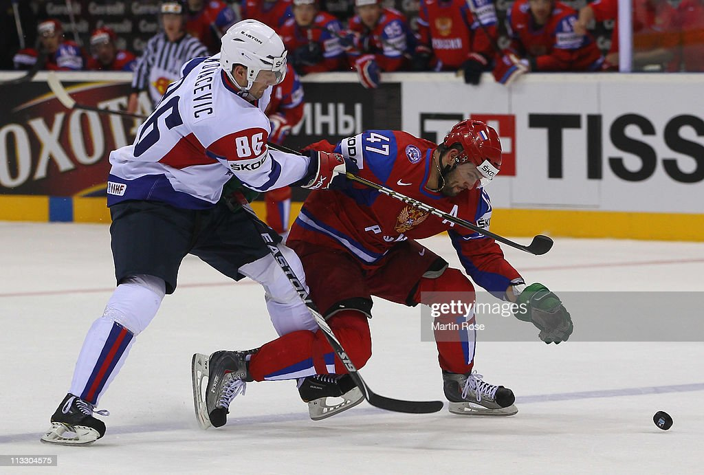 Alexander Radulov (R) of Russia and Sabahudin Kovacevic (L) of Slovenia battle for the puck during the IIHF World Championship group A match between Russia and Slovenia at Orange Arena on May 1, 2011 in Bratislava, Slovakia.