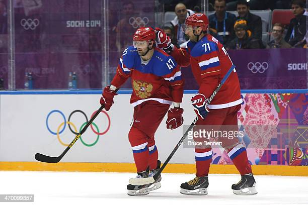 Alexander Radulov of Russia celebrates a goal with teammate Ilya Kovalchuk after scoring an open net goal in the third period against Norway during...