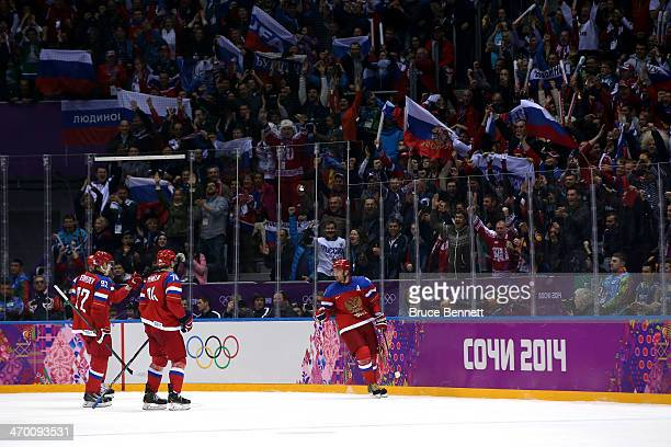 Alexander Radulov of Russia celebrates with his teammates scoring a goal in the second period against Lars Haugen of Norway during the Men's Ice...