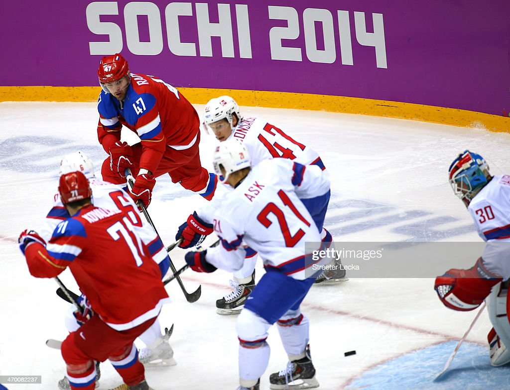 Alexander Radulov of Russia scores a goal in the second period against Lars Haugen of Norway during the Men's Ice Hockey Qualification Playoff game...