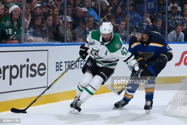 Alexander Radulov of the Dallas Stars controls the puck as Joel Edmundson of the St Louis Blues defends on October 7 2017 at Scottrade Center in St...