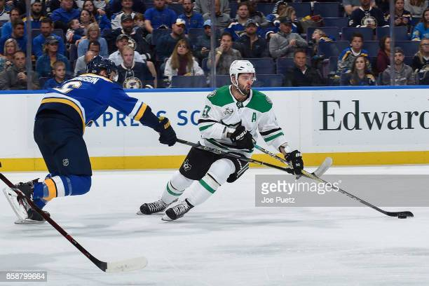 Alexander Radulov of the Dallas Stars handles the puck as Joel Edmundson of the St Louis Blues defends at Scottrade Center on October 7 2017 in St...