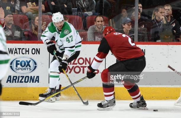Alexander Radulov of the Dallas Stars passes the puck away from Luke Schenn of the Arizona Coyotes during the second period at Gila River Arena on...