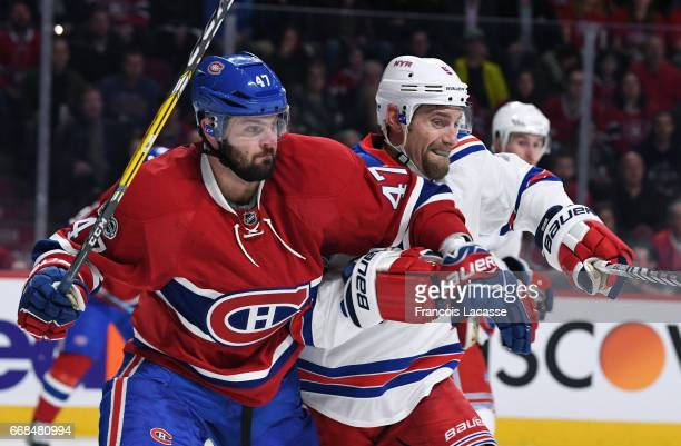 Alexander Radulov of the Montreal Canadiens battle for position against Dan Girardi of the New York Rangers in Game One of the Eastern Conference...