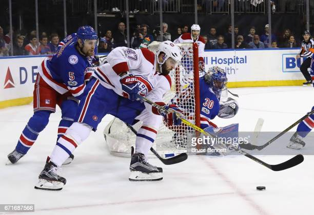 Alexander Radulov of the Montreal Canadiens brings the puck in front of Henrik Lundqvist of the New York Rangers in Game Six of the Eastern...