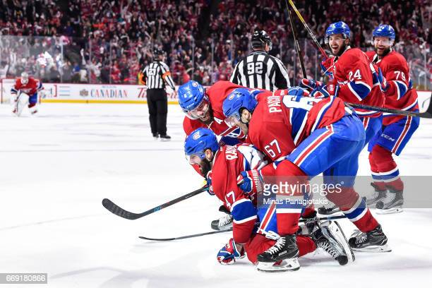 Alexander Radulov of the Montreal Canadiens celebrates his game winning goal in overtime with teammates against the New York Rangers in Game Two of...