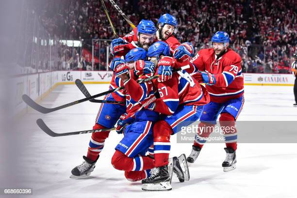 Alexander Radulov of the Montreal Canadiens celebrates his overtime goal with teammates against the New York Rangers in Game Two of the Eastern...