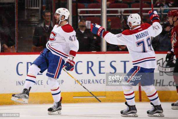 Alexander Radulov of the Montreal Canadiens celebrates with Andrei Markov after scoring a goal against the Arizona Coyotes during the third period of...