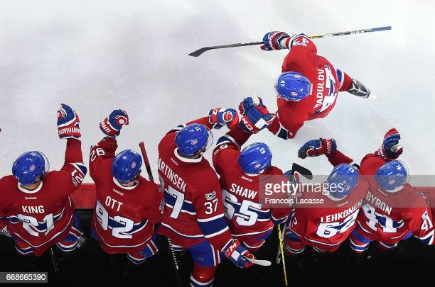 Alexander Radulov of the Montreal Canadiens celebrates with the bench after scoring a goal against the New York Rangers in Game Two of the Eastern...