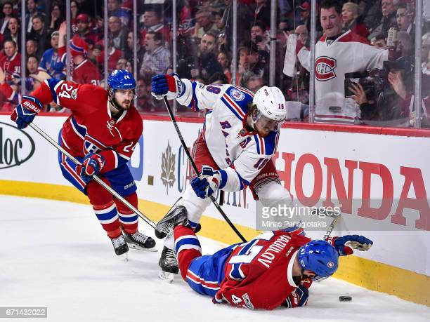 Alexander Radulov of the Montreal Canadiens falls to the ice as he battles for the puck against Marc Staal of the New York Rangers in Game Five of...