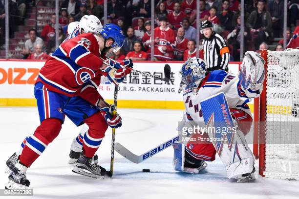 Alexander Radulov of the Montreal Canadiens gets a shot on goaltender Henrik Lundqvist of the New York Rangers in Game Two of the Eastern Conference...