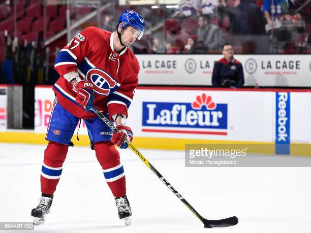 Alexander Radulov of the Montreal Canadiens looks to play the puck during the warmup prior to the NHL game against the Chicago Blackhawks at the Bell...