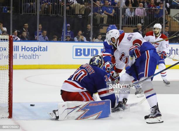 Alexander Radulov of the Montreal Canadiens scores at 1535 of the third period against Henrik Lundqvist of the New York Rangers in Game Three of the...
