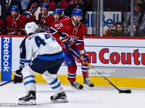 Alexander Radulov of the Montreal Canadiens skates the puck against Josh Morrissey of the Winnipeg Jets during the NHL game at the Bell Centre on...