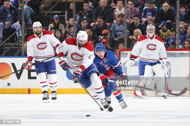 Alexander Radulov of the Montreal Canadiens skates with the puck against Jimmy Vesey of the New York Rangers in Game Six of the Eastern Conference...