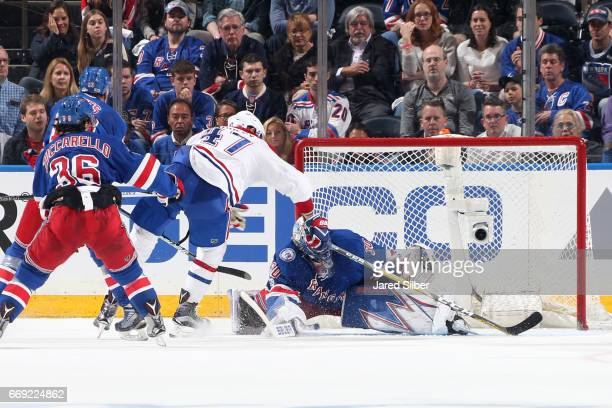 Alexander Radulov of the Montreal Canadiens slides the puck past Henrik Lundqvist of the New York Rangers for a goal in the third period in Game...
