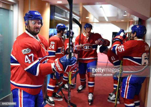 Alexander Radulov of the Montreal Canadiens walk to the ice before the game against the New York Islanders battle for position in the NHL game at the...