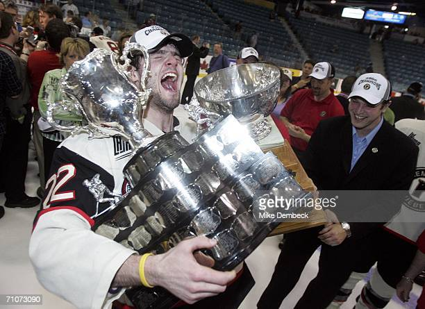 Alexander Radulov of the Quebec Remparts holds up both the Memorial Cup and the Stafford Smythe Memorial Trophy awarded to the most valuable player...