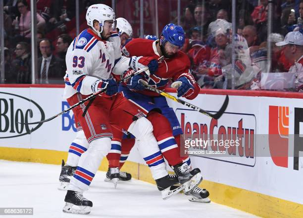 Alexander Radulov the Montreal Canadiens and Mika Zibanejad of the New York Rangers fight for the puck in Game Two of the Eastern Conference...
