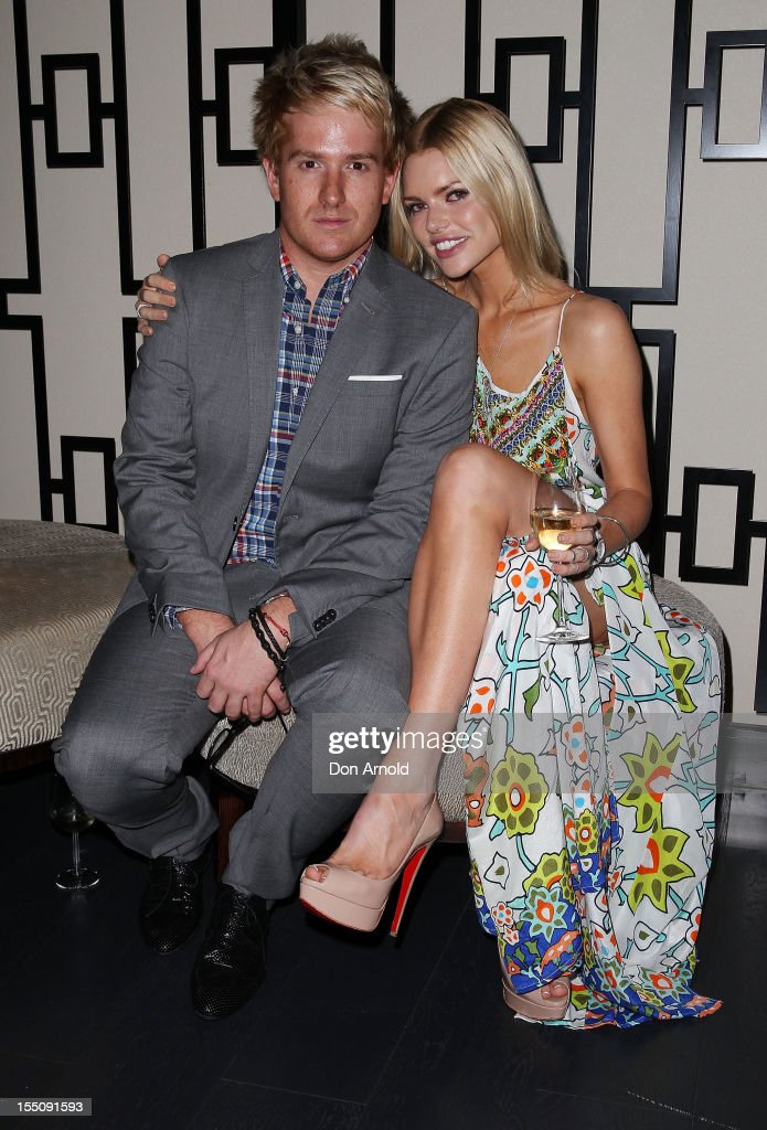 Alexander Reid and <a gi-track='captionPersonalityLinkClicked' href=/galleries/search?phrase=Sophie+Monk&family=editorial&specificpeople=204588 ng-click='$event.stopPropagation()'>Sophie Monk</a> pose at the book launch of 'Nomad Two Worlds' by Russell James on November 1, 2012 in Sydney, Australia.