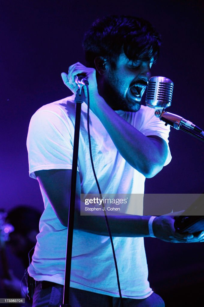 Alexander Ridha of Young The Giant performs during the 2013 Forecastle Festival at Waterfront Park on July 12, 2013 in Louisville, Kentucky.