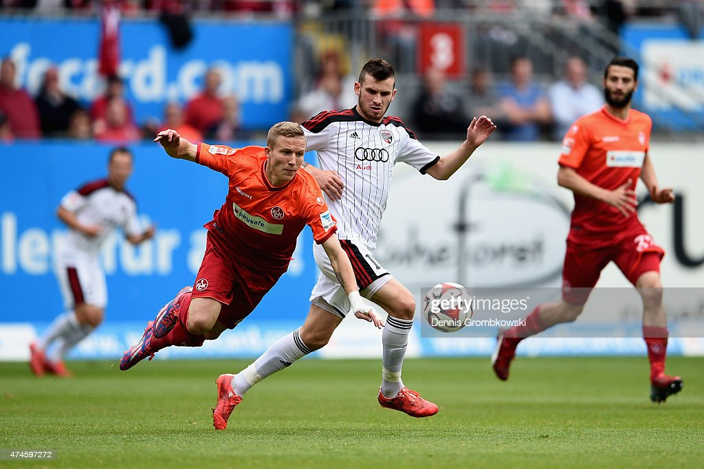 <a gi-track='captionPersonalityLinkClicked' href=/galleries/search?phrase=Alexander+Ring&family=editorial&specificpeople=5588968 ng-click='$event.stopPropagation()'>Alexander Ring</a> of 1. FC Kaiserslautern is challenged by <a gi-track='captionPersonalityLinkClicked' href=/galleries/search?phrase=Pascal+Gross&family=editorial&specificpeople=5395333 ng-click='$event.stopPropagation()'>Pascal Gross</a> of FC Ingolstadt during the Second Bundesliga match between 1. FC Kaiserslautern and FC Ingolstadt at Fritz-Walter-Stadion on May 24, 2015 in Kaiserslautern, Germany.