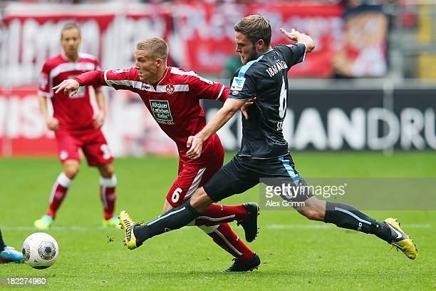 Alexander Ring of Kaiserslautern is challenged by Dominik Stahl of Muenchen during the Second Bundesliga match between 1 FC Kaiserslautern and TSV...