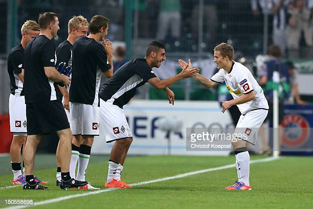 Alexander Ring of Moenchengladbach celebrates the first goal with Tolga Cigerci during the UEFA Champions League playoff first leg match between...