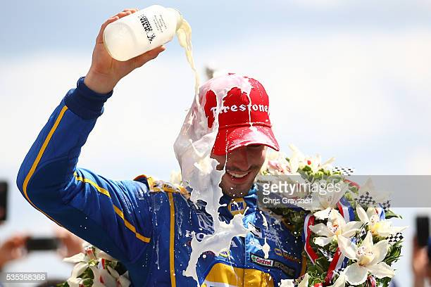 Alexander Rossi driver of the NAPA Auto Parts Andretti Herta Autosport Honda celebrates after winning the 100th running of the Indianapolis 500 at...