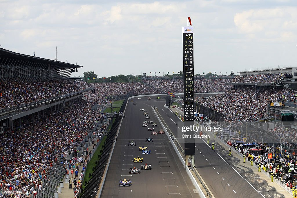<a gi-track='captionPersonalityLinkClicked' href=/galleries/search?phrase=Alexander+Rossi&family=editorial&specificpeople=6547871 ng-click='$event.stopPropagation()'>Alexander Rossi</a>, driver of the #98 NAPA Auto Parts Andretti Herta Autosport Honda leads a pack of cars during winning the 100th running of the Indianapolis 500 at Indianapolis Motorspeedway on May 29, 2016 in Indianapolis, Indiana.