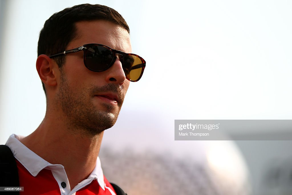<a gi-track='captionPersonalityLinkClicked' href=/galleries/search?phrase=Alexander+Rossi&family=editorial&specificpeople=6547871 ng-click='$event.stopPropagation()'>Alexander Rossi</a> of the United States and Manor Marussia arrives in the paddock before final practice for the Formula One Grand Prix of Singapore at Marina Bay Street Circuit on September 19, 2015 in Singapore.