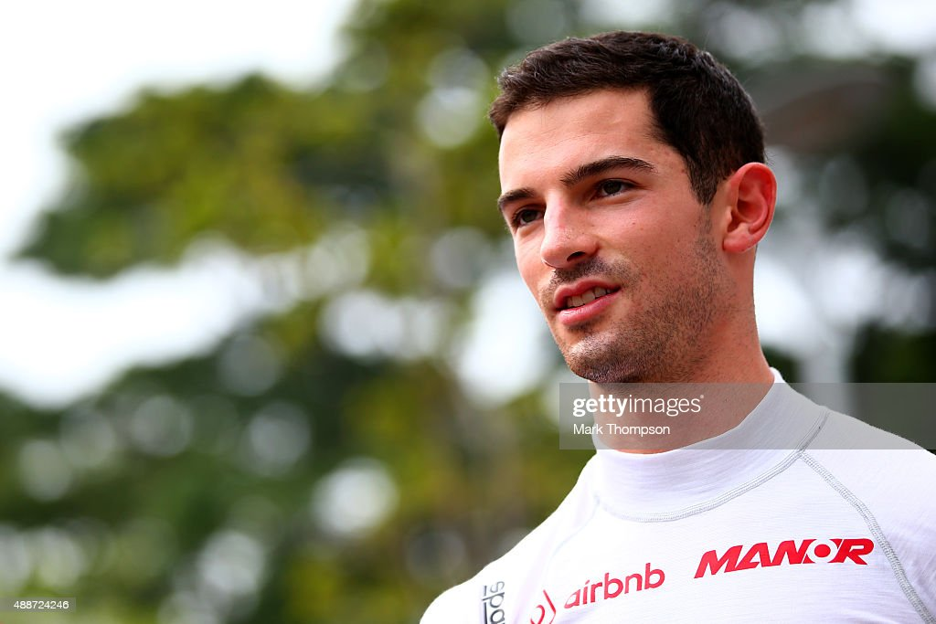 <a gi-track='captionPersonalityLinkClicked' href=/galleries/search?phrase=Alexander+Rossi&family=editorial&specificpeople=6547871 ng-click='$event.stopPropagation()'>Alexander Rossi</a> of the United States and Manor Marussia walks in the paddock during previews to the Formula One Grand Prix of Singapore at Marina Bay Street Circuit on September 17, 2015 in Singapore.