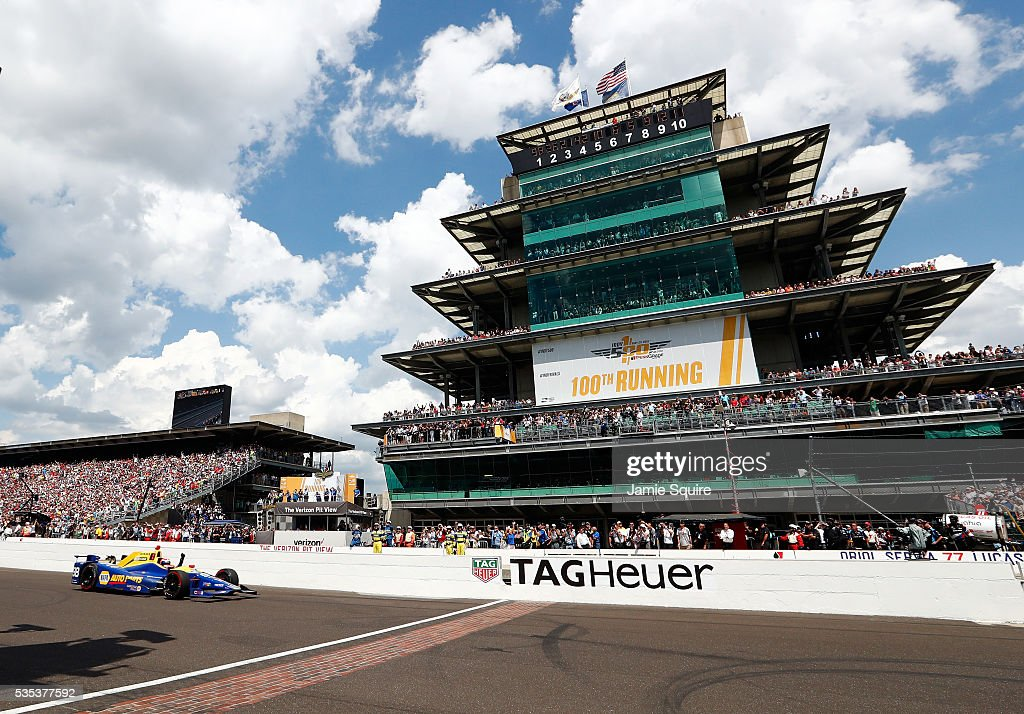 <a gi-track='captionPersonalityLinkClicked' href=/galleries/search?phrase=Alexander+Rossi&family=editorial&specificpeople=6547871 ng-click='$event.stopPropagation()'>Alexander Rossi</a> of the United States pumps his fist as he crosses the finish line to win the 100th running of the Indianapolis 500 at Indianapolis Motorspeedway on May 29, 2016 in Indianapolis, Indiana.