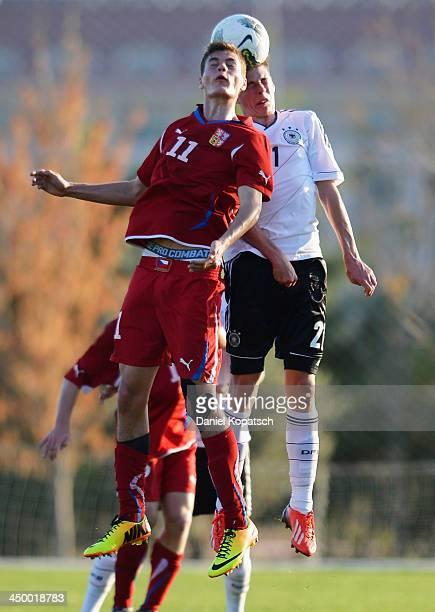 Alexander Rossipal of Germany jumps for a header with Patrik Schick of Czech Republic during the U18 international friendly match between Czech...