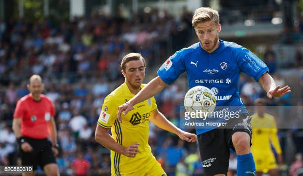 Alexander Ruud Tveter of Halmstad BK and Dennis Olsson of GIF Sundsvall competes for the ball during the Allsvenskan match between Halmstad BK and...