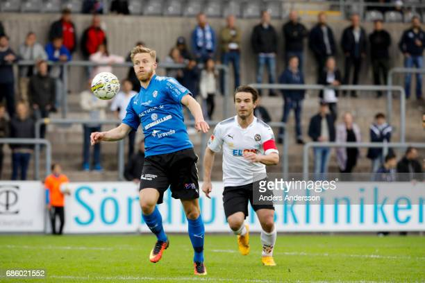 Alexander Ruud Tveter of Halmstad BK and Nordin Gerzic of Orebro SK compete during the Allsvenskan match between Halmstad BK and Orebro SK at Orjans...