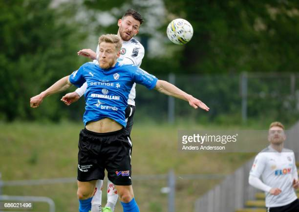 Alexander Ruud Tveter of Halmstad BK Brendan HinesIke of Orebro SK competes for the ball during the Allsvenskan match between Halmstad BK and Orebro...