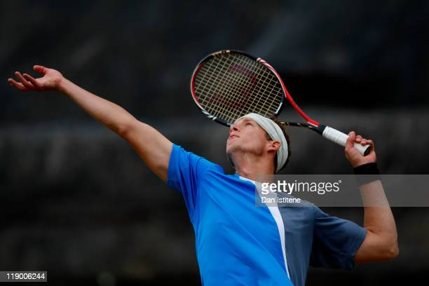 Alexander Sadecky of Switzerland serves during the men's singles second round match between George Morgan of Great Britain and Alexander Sadecky of...