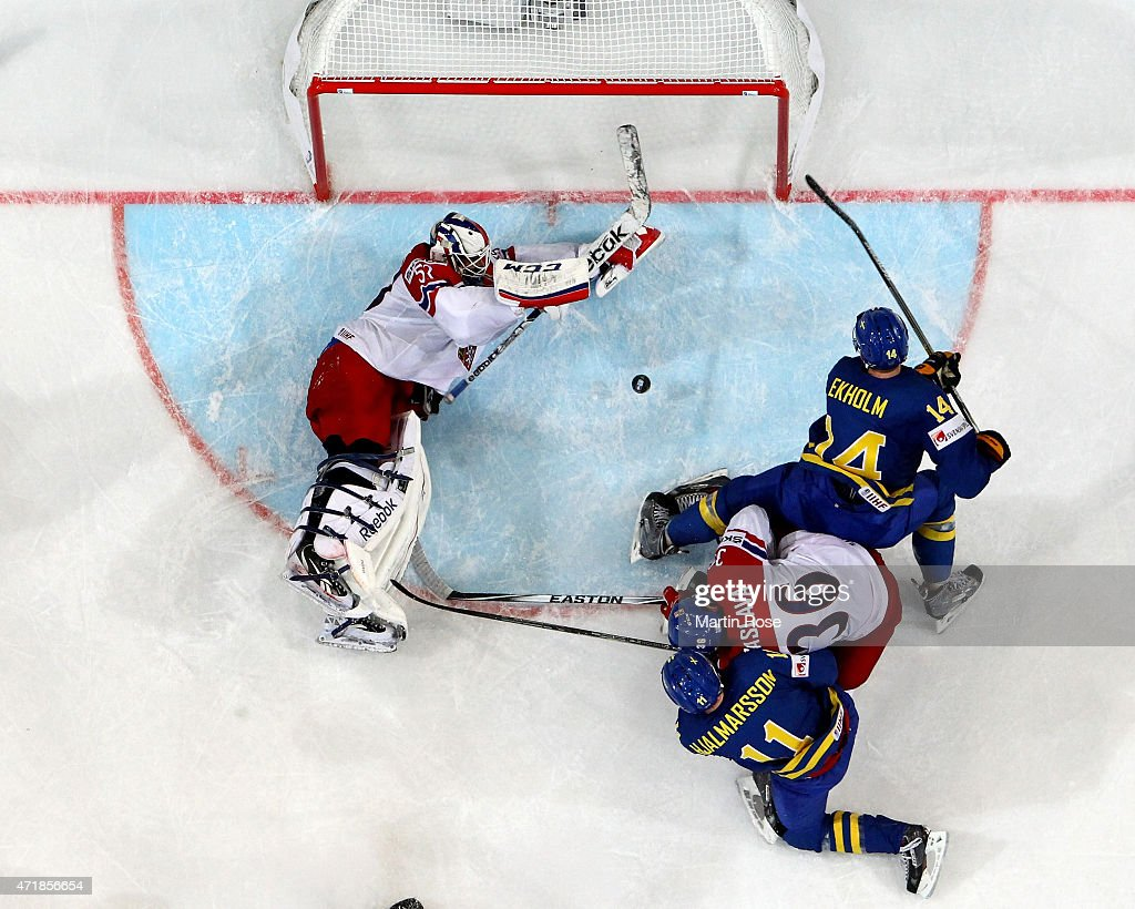 Alexander Salak (R), goaltender of Czech Republic stops the shot of <a gi-track='captionPersonalityLinkClicked' href=/galleries/search?phrase=Mattias+Ekholm&family=editorial&specificpeople=6705085 ng-click='$event.stopPropagation()'>Mattias Ekholm</a> #14 of Sweden battle for the puck during the IIHF World Championship group A match between Czech Republic and Sweden at o2 Arena on May 1, 2015 in Prague, Czech Republic.
