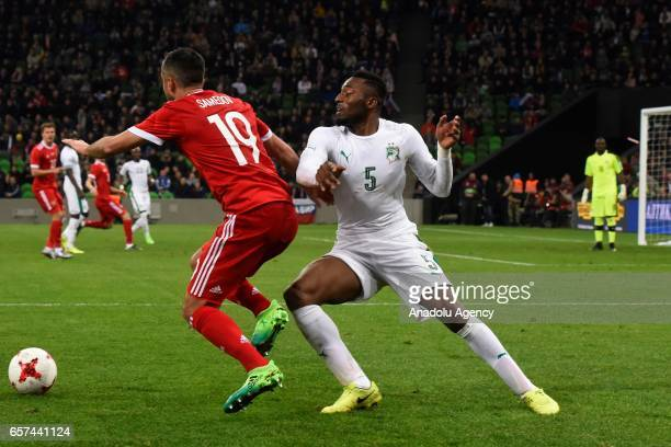 Alexander Samedov of Russia in action against Wilfried Kanon of Cote d'Ivoire's during the friendly football match at Krasnodar Stadium in Krasnodar...