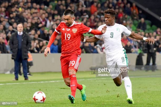 Alexander Samedov of Russia in action against Wilfried Zaha of Cote d'Ivoire's during the friendly football match at Krasnodar Stadium in Krasnodar...