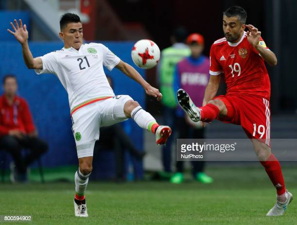 Alexander Samedov of Russia national team and Luis Reyes of Mexico national team vie for the ball during the Group A FIFA Confederations Cup Russia...