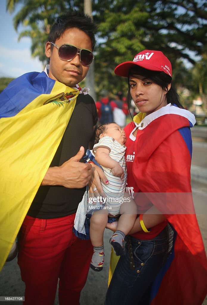 Alexander Sanchez, Christopher Sanchez and Yenirath Gonzalez pose after waiting in line to view the body of deceased Venezuelan President Hugo Chavez on March 9, 2013 in Caracas, Venezuela. Venezuelans continue to wait in line for hours to pay their last respects to Chavez on the day after his funeral. Venezuela's elections commission has set April 14 as the date for voting to replace the late Chavez.
