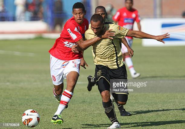 Alexander Sanchez of Juan Aurich fights for the ball with Yonaider Ortega of Itagui during a match between Juan Aurich and Itagui as part of The Copa...